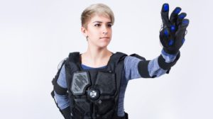 Woman in haptic suit. Haptics are a great tool for VR marketing.